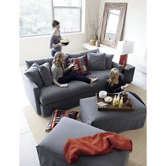 Extra deep Lounge Slipcovered Ottoman with Casters in Ottomans, Cubes | Crate and Barrel