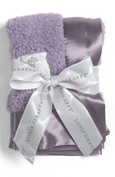 Infant Little Giraffe 'Bella' Security Blanket - Purple (845554007170) A plush, snuggly blanket is crafted from sueded, ultrafine microfiber fabric for a lavishly soft finish, while the rich satin border provides a cool, contrasting element that helps soothe your precious little one. Color(s): blue, cream, flax, lavender, pink. Brand: Little Giraffe. Style Name: Little Giraffe 'Bella' Security Blanket. Style Number: 947221.