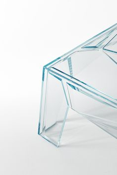 HYPERtable | design Mario Bellini | GLAS ITALIA 2017 collection |  Low table in transparent 10mm extralight glass glued at 45°, the lower surface of which is completely covered by sheets of transparent irregularly shaped extralight glass. The edges present different and varied bevelling which differ both in the degree of incline and in width. The resultant table is one which seems to be a magical set of prisms with unlimited faceting and unexpected reflections.  #glasitalia #mariobellini…