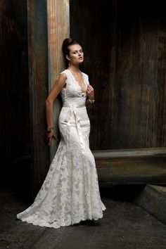 """Z266 Sposa line by St. Pucchi dress three.This Soft detailed lace dress with its natural edges and colored sash shows a wedding dress is to aid in showing you at your best not you showing the dress at its best. In 25 or 50 years from you wedding you will still be in style in this dress as you say """"I Do"""" all over again to the love of your life. True elegance never goes out of style and will never be picutres to hide because of the trends of the time you first said """"I Do"""""""