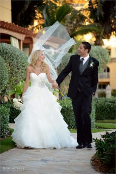 """Tying the knot at @The Ritz-Carlton in Palm Beach – Seth and Svetlana's spectacular outdoor #wedding! Svetlana was simply stunning in a beautiful #wedding #gown and #Manolo #Blahnik heels with @Swarovski #crystals. """"Lana was one of the sweetest #brides I've had the opportunity of working with"""" says Nicole Hochman of #Bridal #Couture of Boca Raton.  #Wedding #portrait of the #bride and the #groom by #DominoArts #Photography (www.DominoArts.com)"""