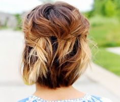 Fend off rain-induced unruly hair by twisting small sections and pinning them back with bobby pins. In this case, natural wave and texture only boostthe look of the 'do.