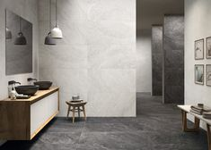 Discover the new natural variation tile trend! Celebrate the different tones and shades of porcelain tiles and limestone flooring. Learn more at Mandarin Stone. Black Tile Bathrooms, Modern Bathroom Tile, Bathroom Tile Designs, Bathroom Interior Design, Modern Bathrooms, Bathroom Ideas, Family Bathroom, Bathroom Inspiration, Reggio Emilia