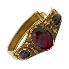 Victorian Cabochon Garnet Bangle Bracelet | From a unique collection of vintage bangles at https://www.1stdibs.com/jewelry/bracelets/bangles/