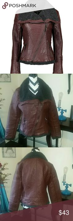 Urban Republic faux leather faux fur moto jacket Brand new with tags. Never worn, just tried on for a minute. Only selling because it's a little too big for me, and I can't return it. The fuzzy part is only a partial lining and does not line the whole jacket (shown in the third pic). The color is like a deep wine-ish brown.   NO TRADES, but I do give a 20% off discount on bundles :-) Urban Republic Jackets & Coats