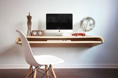 space saving desk for office with laminate material in front of white office chair