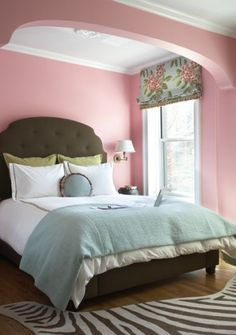 Brown and soft blue in a pink room create an elegant and soothing space. Paint pick: Oleander, Sherwin-Williams
