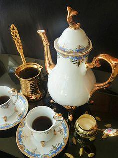Arabic coffee with a beautiful tea set and Ibrik.