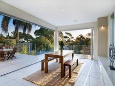 Indoor-outdoor outdoor living design with deck