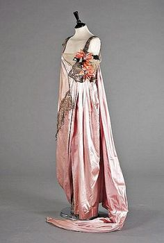A pink satin Worth ball gown
