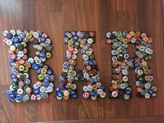 12 inches high, can be hung on wall or placed on shelves, available in black wood or unfinished wood, (please specify when ordering) all letters available individually, as well, see other listing.. caps vary with each piece, as they are made to order Bottle Cap Table, Beer Bottle Caps, Bottle Cap Art, Beer Caps, Diy Projects To Try, Crafts To Make, Fun Crafts, Craft Projects, Arts And Crafts
