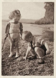 Brother and sister playing by the Danube, from a real-photo postcard, Hungary, 1943, photographer unknown.