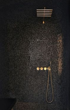 CONTEMPORARY vibe from black mosaic tiles cantilevered black seat simple lines minimalist look. GLAM factor from glossy-finished gray mosaic tiles that reflect light gold-finished rain shower & shower controls. Bad Inspiration, Bathroom Inspiration, Bathroom Ideas, Bathroom Colors, Bathroom Makeovers, Bathroom Designs, Bathroom Furniture, Diy Furniture, Black Shower