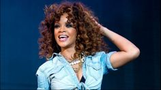 Rihanna onstage with pretty brown curls #rihanna #hair #fashion.  I'm doing my hair this color!