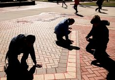 Delaney Cordova & Kent State University: The demonstration uses red sand in sidewalk cracks to represent those who have fallen through the cracks in our society. Those who are scarred and in plain sight but have no voice. Victims of human trafficking or modern day slavery. It's meant to be bright and eerie to spark people's curiosity that leads to them asking questions. The goal is to raise awareness and start a conversation to educate people on this tragedy that goes on in every country, every Sand Projects, Kent State University, Spark People, Human Trafficking, Curiosity, Conversation, Goal, Sidewalk, Bright