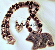 Snowflake obsidian bear on necklace of snowflake obsidian beads, buffalo horn beads, silver tone spacers and findings earrings to match $25.00