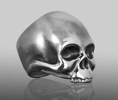 """""""KEITH"""" – A silver skull ring inspired by Keith Richards.  """"I've never had a problem with drugs, I've had problems with the police."""" Keith Richards  An exact re-creation of Keith Richards skull. We utilized forensic sculpting (facial reconstruction) techniques and over 50 photos including police mug shots of the Rolling Stone to create our design. His features are characterized as a typical European male with angled forehead, deep set eyes and a strong brow line with a high nasal bridge.  •…"""