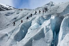 Hike across the blue ice of the thousand-year Nigardsbreen Glacier in Norway's Jostedal National Park.