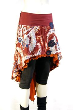 Fabric Woven paisley fabric with orange stretch layer underneath and a rust…