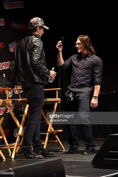 Jeffrey Dean Morgan and Norman Reedus attend AMC presents 'The Walking Dead' at New York Comic Con at The Theater at Madison Square Garden on October 8, 2016 in New York City.