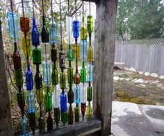 How to Build a Wall From Recycled Bottles: Backyard project - instructions for building a wall from recycled bottles. Part of incredible landscaping project Glass Bottle Crafts, Bottle Art, Glass Bottles, Wine Bottles, Bottle Candles, Vodka Bottle, Wine Bottle Fence, Wine Wall Art, Bottle Trees