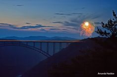July 4th fireworks over Adventures on the Gorge next to the beautiful New River Gorge in southern West Virginia. © Amanda Haddox