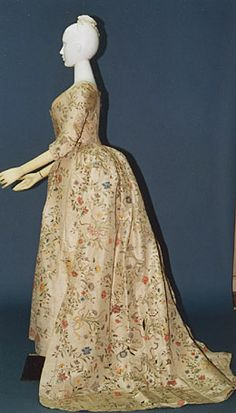 Dress  (robe à l'anglaise)  c. 1785 (fabric mid-18th Century) English  White hand-painted china silk; boned at center back; compère front; matching petticoat (jupe).  Inv. AC313 77-12-28AB