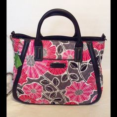 """Vera Bradley Trapeze Tote Cherry Blossom NWT Vera Bradley Trapeze Tote, Cherry Blossom. Double Handles & Shoulder straps. Faux Leather Trim. Recessed zip top closure. 3 inside slip pockets, 1 inside zipper pocket, outside front slip pocket, ideal for keys/Phone. Measurements 12 1/2"""" W x 12 1/2"""" H x 6 1/2"""" D with 5"""" drop strap.                                                                 Price is Firm No Trades  Vera Bradley Bags Totes"""