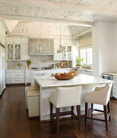 beautiful kitchen with rustic planked ceilings. I love all the whites.. it's stunning!