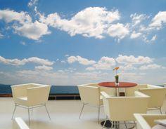 Fotobehang wolken aan de blauwe hemel