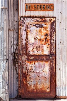 Art photo of a rusty metal industrial door with no smoking sign and corrugated metal. Art wall décor photography with distressed metal door Industrial Bookshelf, Industrial Door, Industrial Bedroom, Industrial Interiors, Industrial Design, Industrial Wallpaper, Industrial Living, Industrial Farmhouse, Industrial Chic