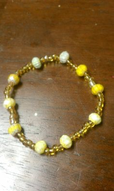 This yellow braclet has a nice mixed colored gem