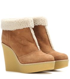 Chloé - Suede and shearling wedge ankle boots - For a luxe look when the cold weather hits, slip into these cosy ankle boots from Chloé. The shearling-lined pair is coated in smooth tan suede and finished with a chunky rubber wedge heel. Let them elevate any look this fall and winter. seen @ www.mytheresa.com