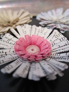 Paper flowers from recycled paper made into magnets