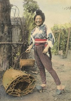 A Japanese farmer girl, in traditional clothing, carrying a basket, 1921. National Geographic. Note the high geta with covered toes.