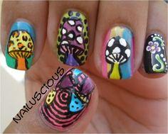 Mushroom nail art done with acrylic paint and nail polish.
