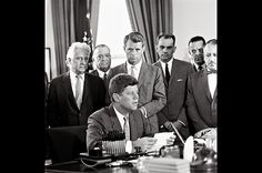 The Signing of S-1656, Sept. 13, 1961 Attorney General Bobby Kennedy, rear center, watches his brother explain his support for an anticrime bill. http://www.rosettabooks.com/ebook/jfks-final-hours-in-texas/