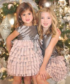 Your prima ballerina will take their breath away in this lovely silver and pink holiday dress for little girls.  This girls Christmas dress is perfect for Christmas photos, parties or special occasions this dress will give your girl lots of shine for your holiday activities.