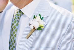 seersucker, plaid tie, cotton in his boutonniere. classic southern wedding.