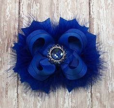 Royal Blue Bow Fluffy Stacked Boutique Bow with Rhinestone Center. $7.99, via Etsy.