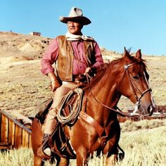John Wayne and Ole Dollor, one of his fovorite horses.I just Love the Dukes Movies Especially his Westerns.