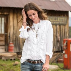 """TIMELESS BIBBED BLOUSE--Our basic white top is anything but. Like winding rivers, decorative stitching meanders over tucks and pleats in an airy, cotton voile blouse. Machine wash. Imported. Exclusive. Sizes XS (2), S (4 to 6), M (8 to 10), L (12 to 14), XL (16). Approx. 28""""L."""