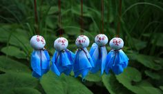 """Hanging """"teru teru bozu,"""" a hand-made doll made of white paper or cloth, at the front of a house in the straight position is a Japanese custom, which is believed to bring good weather for the next day."""