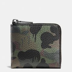 Crafted in rugged and durable pebble leather with a great hand feel, this compact zippered design features Gary Baseman's playful Wild Beast motif reimagined as a camo print.