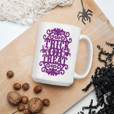 Trick Or Treat - Glossy Ceramic Coffee Mug - Spooky - Halloween - Fall - Autumn - Witch. Whether you're drinking your morning coffee, evening tea, or something in between – this mug's for you! It's sturdy and glossy with a vivid print that'll withstand the microwave and dishwasher.