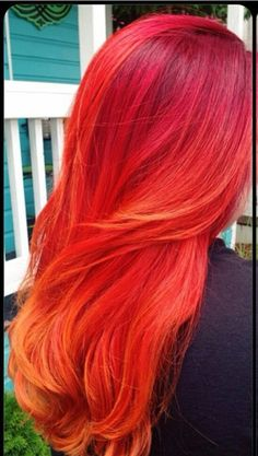 This is nearly exactly what my hair currently looks like. Dark red roots melted into bright fashion red and orange.