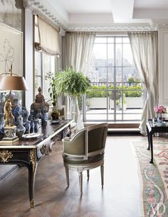 Smith and Shamamian updated the living room's glazing with custom-made steel doors and windows by Optimum; the bureau platand 18th-century chair are both auction finds.