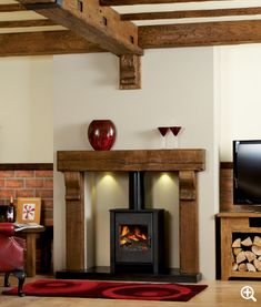 The Gatsby surround is produced from solid air-dried European Oak, cut from the heart of the log and features natural knots, splits and shakes. Steel Beam Covers and Wall and Ceiling Spars can be made to any dimension and finished to match your fireplace. Wooden Fire Surrounds, Wooden Fireplace Surround, Log Burner Fireplace, Concrete Fireplace, Wood Burner, Fireplace Surrounds, Bedroom Fireplace, Home Fireplace, Fireplace Design