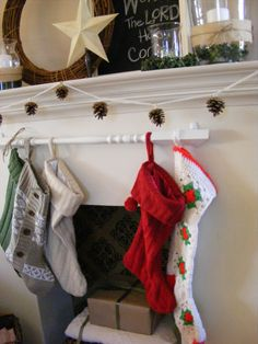 Hang stockings on an extra baluster; hang it on removable adhesive command hooks so it can be removed after Christmas.