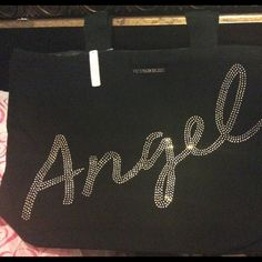 """Victoria's Secret Stunning XL Angel Tote Victoria's Secret presents their """"Angel"""" Collection. Still in plastic cover. Here is their beautiful very large black canvas Angel Tote.  """"Angel"""" is spelled out in glistening simulated aurora borealis lettering. Victoria's Secret Bags Totes"""
